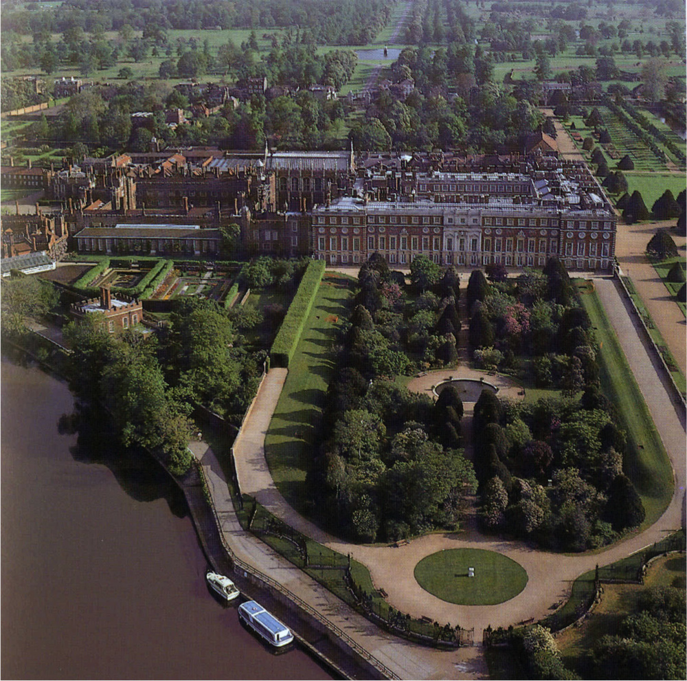 Air view of the south front of Hampton Court in 1992 showing the very overgrown garden. In fact many of the Yew Trees were those that were planted for William III in 1700; cutting them down was our biggest and bravest decision