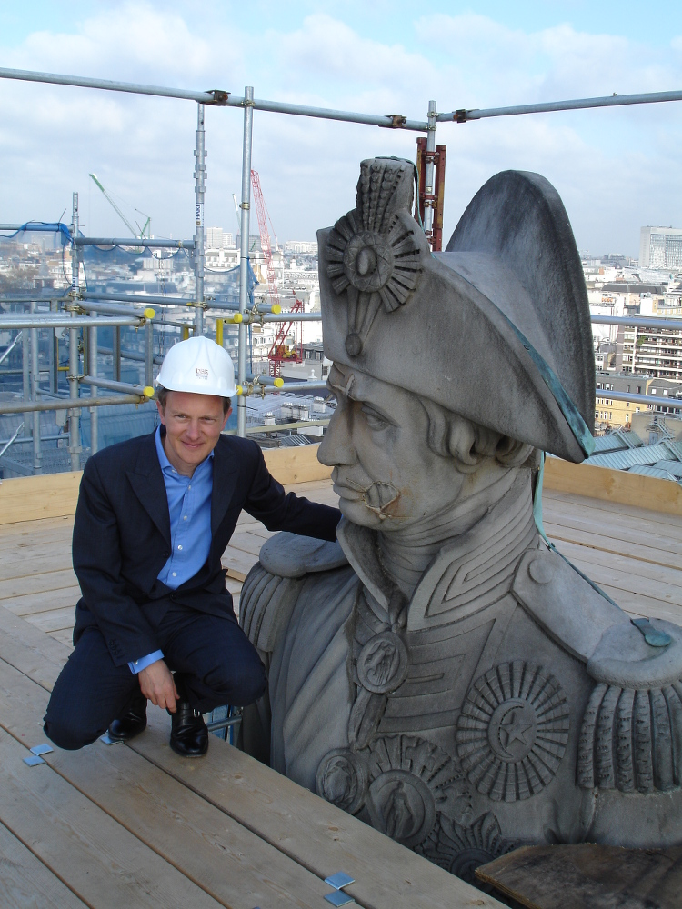 Me inspecting Nelson on top of his column